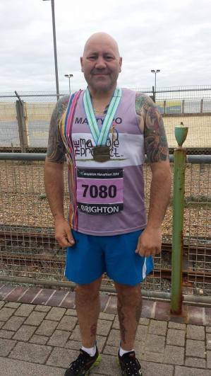 Matt, a proud finisher of the Brighton Marathon 2014
